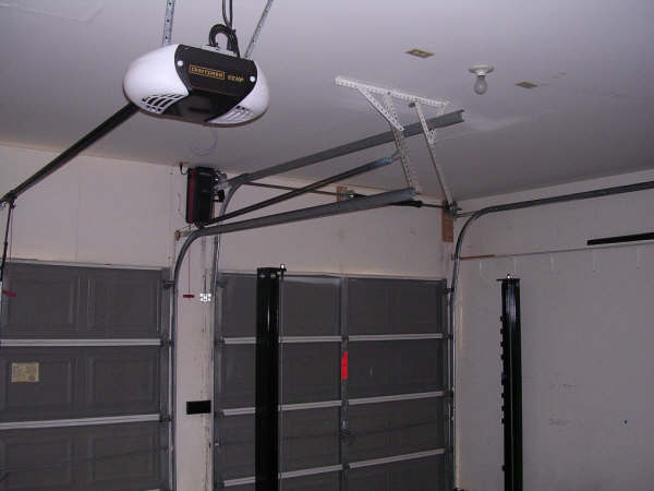 Door lifts 4 our products different types lift doors for Garage modification